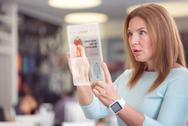 Pleasant surprised woman using tablet Stock Photos