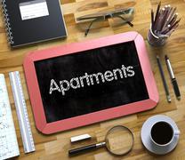 Apartments - Text on Small Chalkboard. 3D Stock Illustration