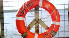 Ring life buoy on big boat .Orange lifesaver on the deck of a cruise ship Stock Footage