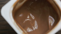 Chocolate mousse eat with a spoon. close-up. top view Stock Footage