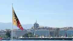 Panorama view of historic Geneva city center with huge geneva flag waving in the Stock Footage