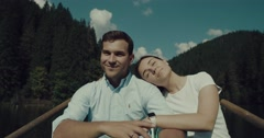 Young couple in love on a rowboat in a lake in Romania Stock Footage