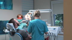 Dental assistant using dental curing lamp. Steadicam. Stock Footage