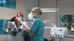 Dentist fills the tooth. Steadicam. Stock Footage