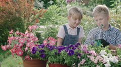 Boy and Girl Working in Garden Stock Footage