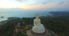 Aerial view the beautify Big Buddha in sunset time Stock Footage