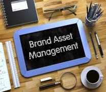 Brand Asset Management Concept on Small Chalkboard. 3D Stock Illustration