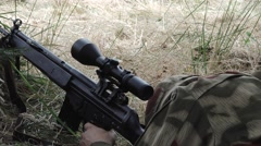 Sniper take up head and aim Stock Footage
