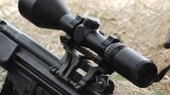 Detail Sniper take up head and aim Stock Footage