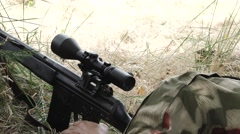 Close sniper aims target and reload gun Stock Footage