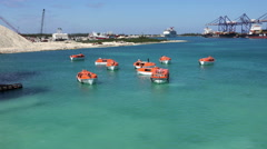 FREEPORT,BAHAMAS-MAY 2016. Life boats of M/V Carnival Valor cruise ship tests 4K Stock Footage