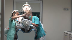Medical dentist personnel at work in dental clinic. Steadicam. Stock Footage
