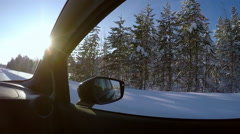 Driving on a Winter Road. Forest, Snow and Sun Stock Footage
