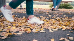 Woman Walking at Autumnal Park on Yellow Leaves Stock Footage