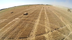 Bales of grain after harvesting a wheat field, aerial view Stock Footage