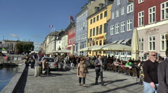 Tourists Strolling Along Street with Restaurants in Nyhavn Stock Footage