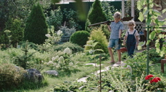 Little Boy and Girl with Shovel in Garden Stock Footage