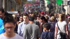 Crowd of people walking on Champs Elysee in Paris Stock Footage