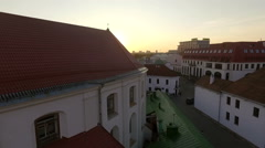 Gorgeous sunset under an old european town, aerial view Stock Footage