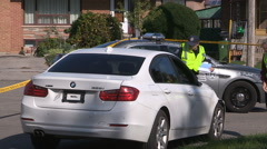 Police investigate stolen car invovled in hit and run fatal accident Stock Footage