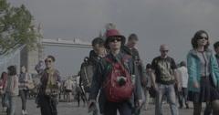 Tourists walking past Tower Bridge - London, England - 4K Stock Footage