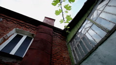 Panorama of an old two-storeyed residential house from red brick. Wide angle. HD Stock Footage