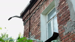 Panoramic view of an old two-storeyed residential house from red brick. HD Stock Footage
