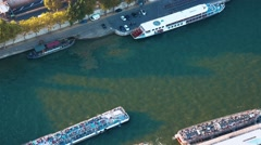 Sightseeing boats on River Seine in Paris - aerial view Stock Footage