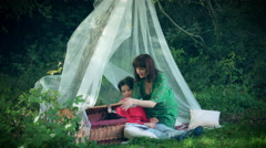 4k Natural Shot of Woman and Child Eating at Picnic Forest Shelter Stock Footage