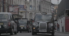 Black Taxi Cab on Shaftsbury Avenue - London, England - 4K Stock Footage