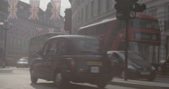 Black Cab and Red Bus on Regent Street / London, England - 4K Stock Footage