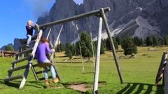Two young girls playing on playground Stock Footage