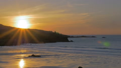 Beach sunset; St Ives, Cornwall, England - slow motion Stock Footage