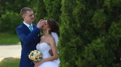Bride and groom at wedding Day walking Outdoors on spring nature. Bridal couple Stock Footage