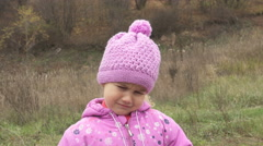 Portrait Adorable Little Girl weeps outdoors in autumn cold day. Stock Footage