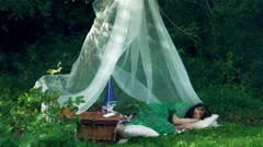 4k Natural Shot of a Woman Dreaming in Forest Shelter Stock Footage