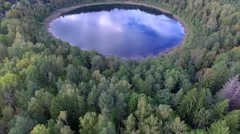 Aerial View on Beautiful Round Lake in a Forest Stock Footage
