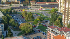 Cars moving on parking lot timelapse with green trees. CROATIA, ZAGREB Stock Footage