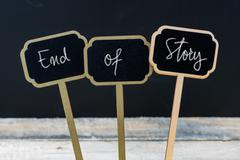 Motivational message End Of Story written with chalk Stock Photos