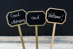Greeting message Good Morning and Welcome written with chalk Stock Photos