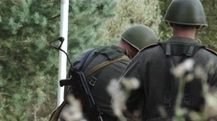 Close Two soldiers search for mines in meadow Stock Footage