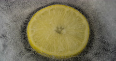 Ice melting. Lemon inside. Stock Footage