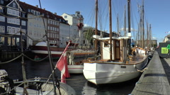 Boats in Canal at Nyhavn in Copenhagen Stock Footage