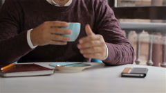 Man enjoys the aroma of the coffee at the cafe Stock Footage