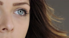 Young beautiful attractive woman with blue eyes closeup portrait of half face Stock Footage