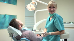 Doctor dentist making an injection of local anesthetic into the gums. Stock Footage