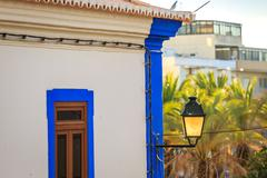 Traditional portuguese house with a lantern illuminated by sunset Stock Photos