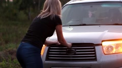 Woman confused because of the failure of her car Stock Footage