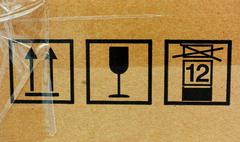 Three fragile symbol on cardboard Stock Photos