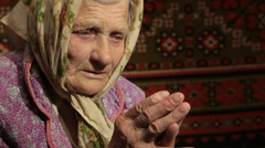 Old Woman Praying To God Stock Footage